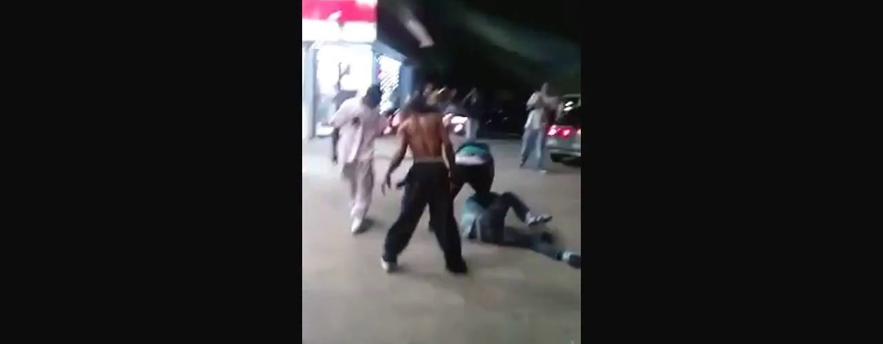 Woman beating up a naked man